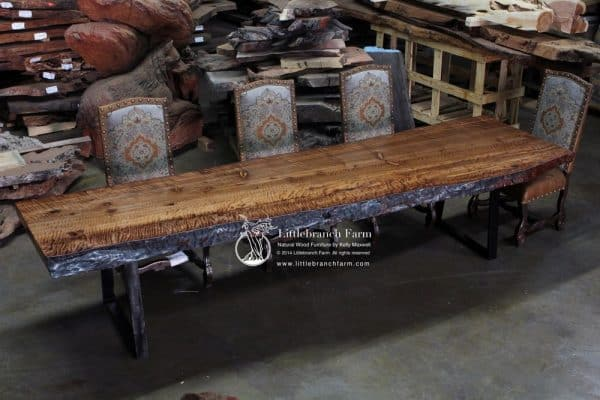 Rustic modern dining table set with wolf carving.