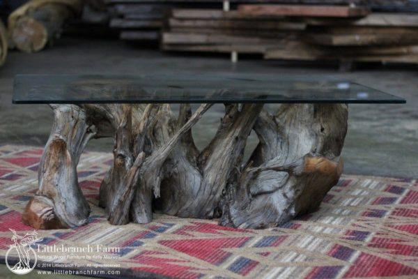 driftwood coffee table on area rug