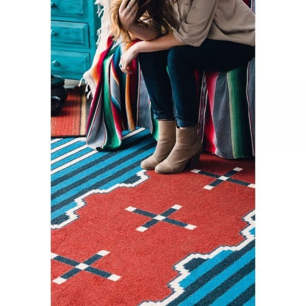 Blue striped red rug.