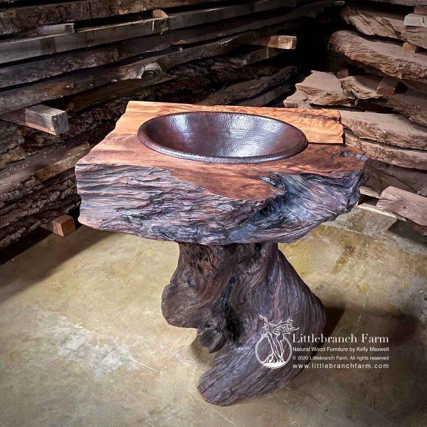 Rustic tree stump bathroom sink.