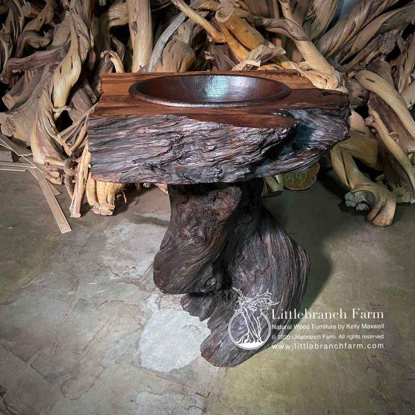 Rustic driftwood bathroom sink.
