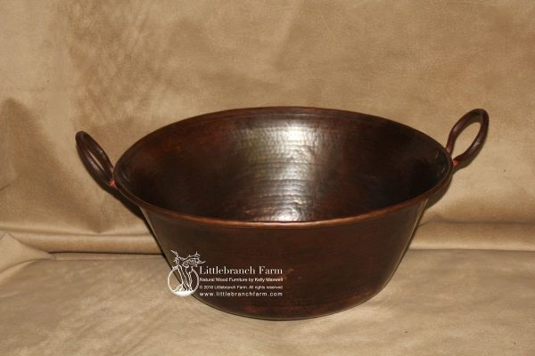 vessel sink made of copper with handles.