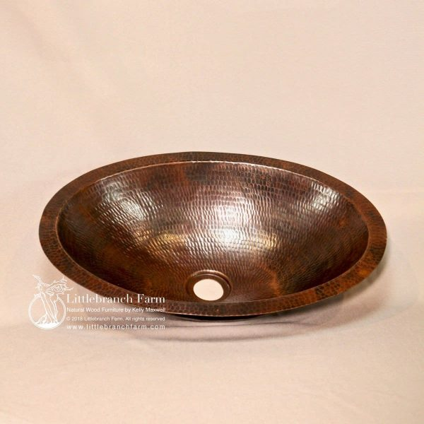 Oval copper sink with patina