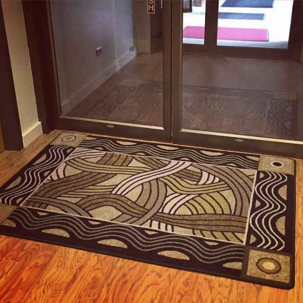 Hand coiled area rug shown in entrance.