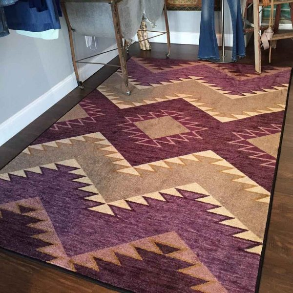 Heritage area rug in Plum color.
