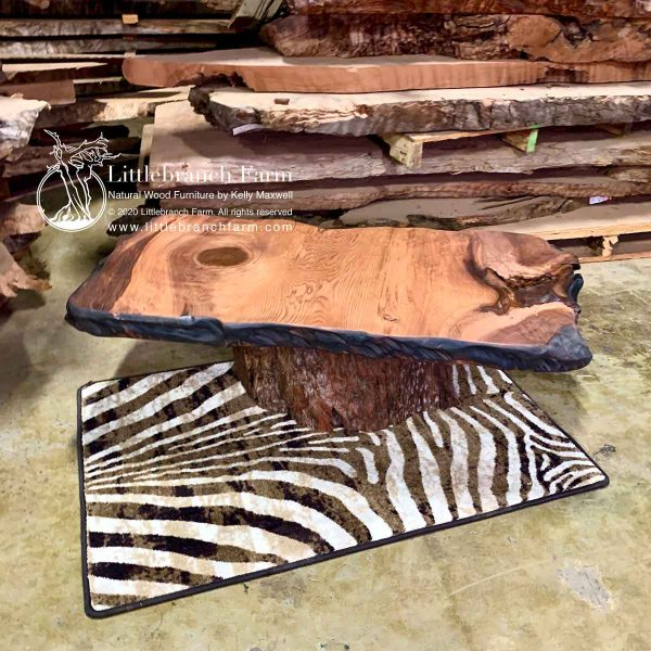 Rustic table on zebra rug.