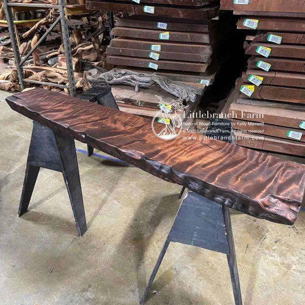 Curly redwood wood mantel
