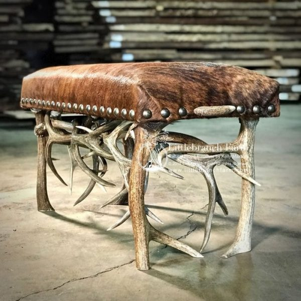 cowhide bench with antler base.