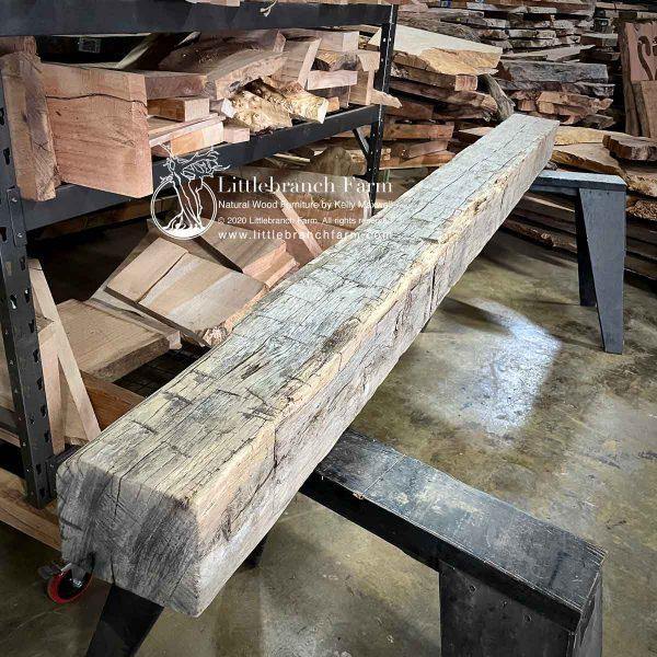Weathered gray hand hew wood beam.