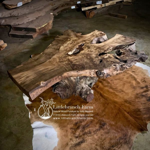 Live edge furniture on cowhide rug