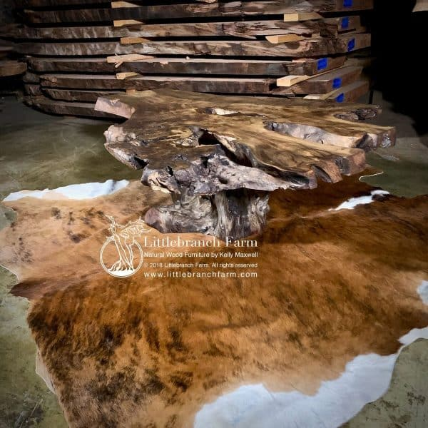 Rustic furniture on cowhide rug.