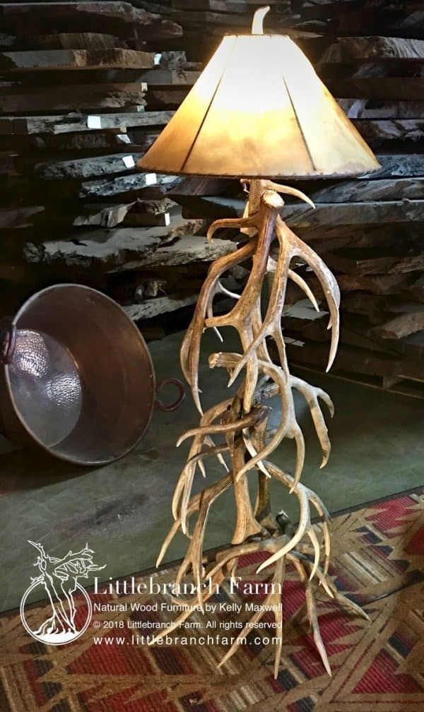Mule Deer and Elk floor lamp with rawhide lamp shade.
