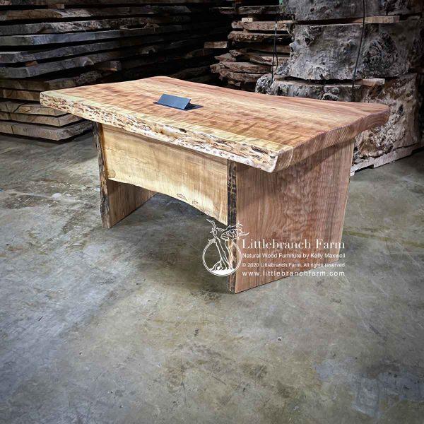Live edge wood slab desk.