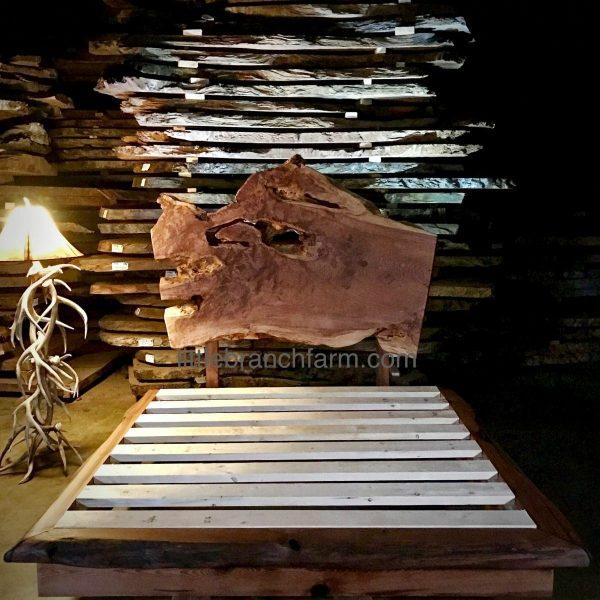 Natural wood platform bed and antler lamp.