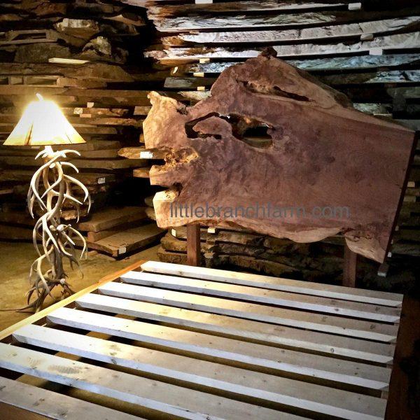 Rustic platform bed with floor lamp
