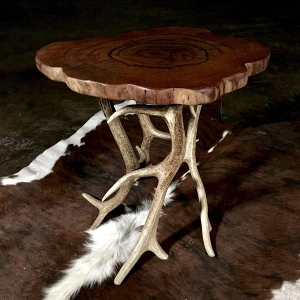 cow hide rug and rustic table
