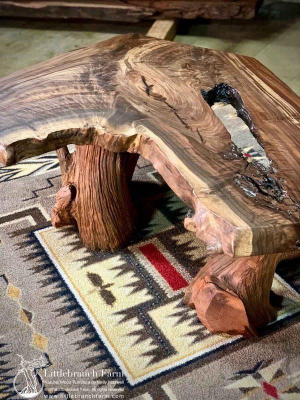 Walnut rustic coffee table on a southwest rug