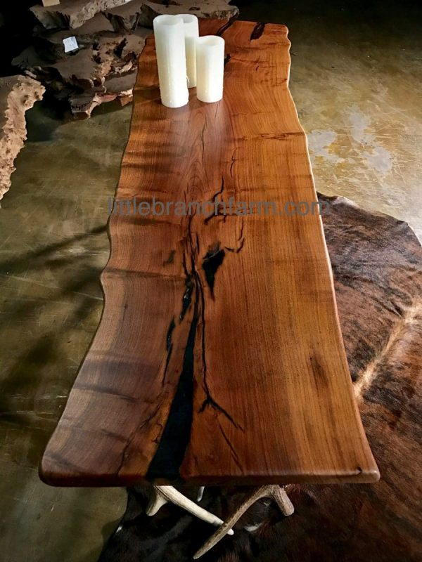 Rustic wood slab on cowhide rug