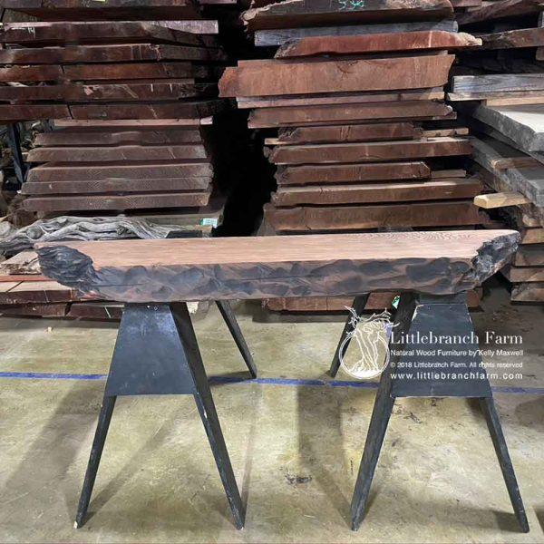 Carved edge redwood mantel.