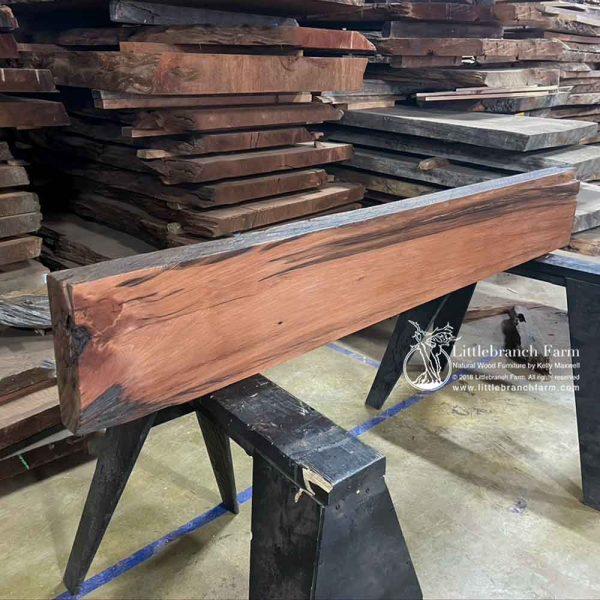 Redwood real wood rustic mantel.
