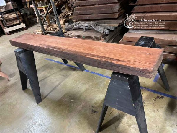 Redwood wood plank fireplace mantel.