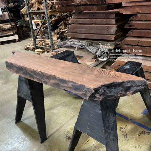 Old-growth redwood mantel.