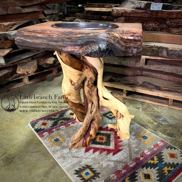 Twisted juniper log vanity on southwest rug.