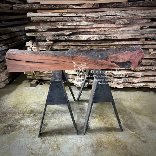 Bottom of a redwood wood slab mantel