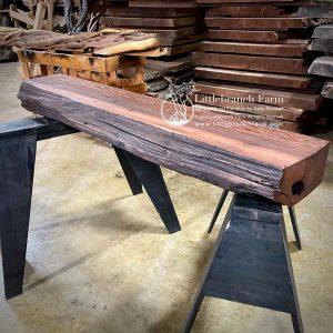 Salvaged Redwood rustic edge wood mantel.