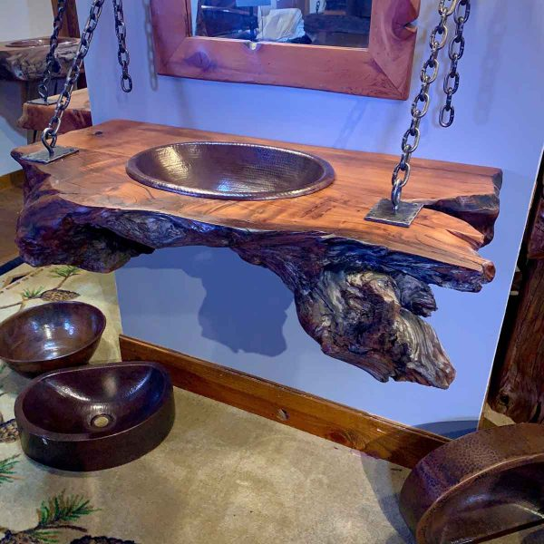 Floating live edge wood with copper sink.