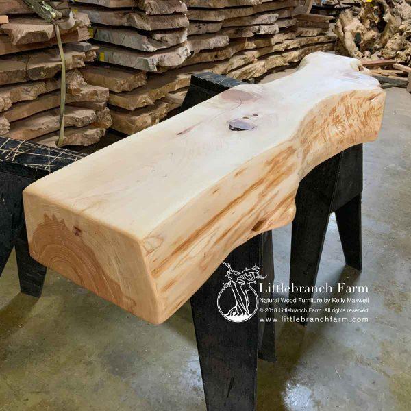 Wood beam fireplace mantel.