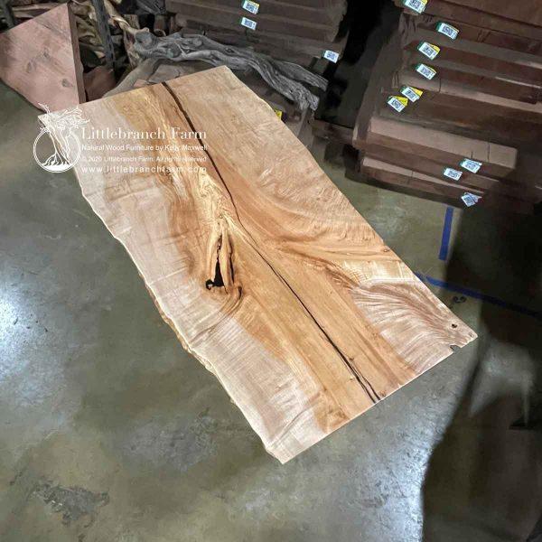 Figured live edge maple wood slab.