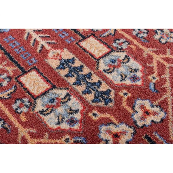 Rust color rug with closeup detail
