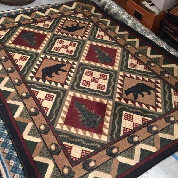 Quilted woodland forest area rug