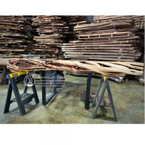 Natural log fireplace mantel