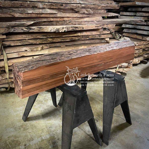 Rustic log fireplace mantel