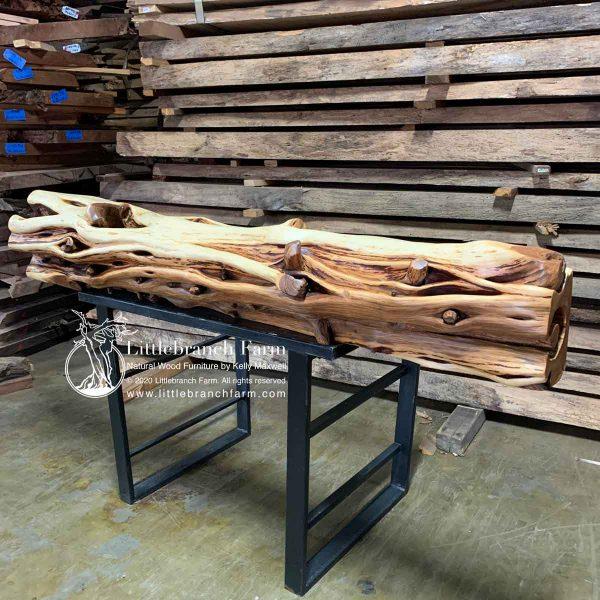 Bottom view of a juniper log fireplace mantel.