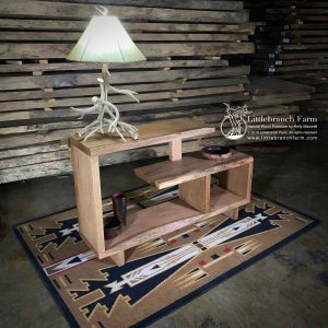 Wood sofa table on southwest rug.