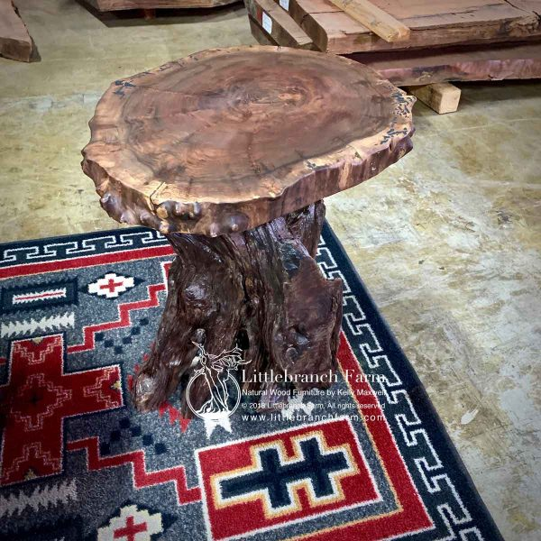 Rustic end table on southwest rug