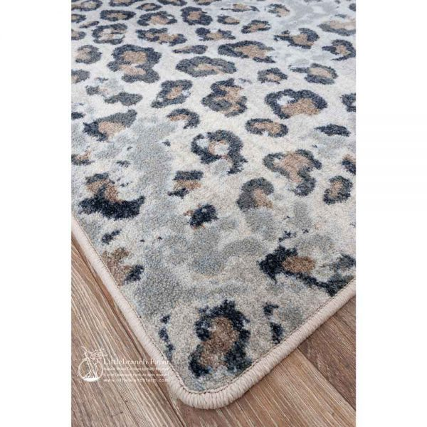 corner detail picture of a leopard rug