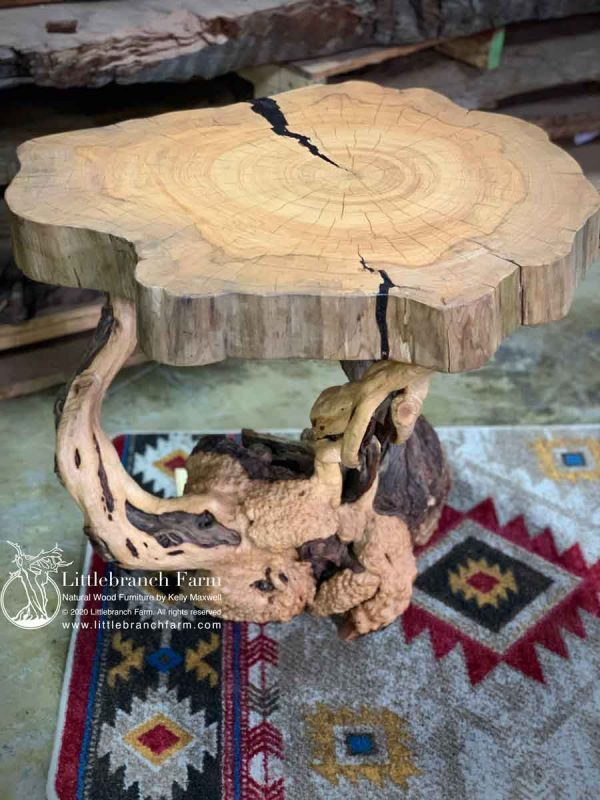 Rustic live edge table on southwest rug.