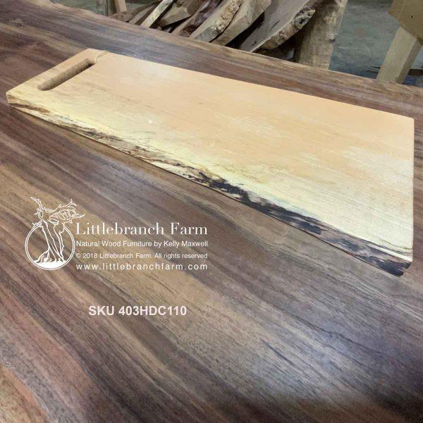 Maple wood plank charcuterie board.